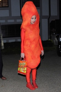Katy Perry as a cheeto with a bag of Cheetos