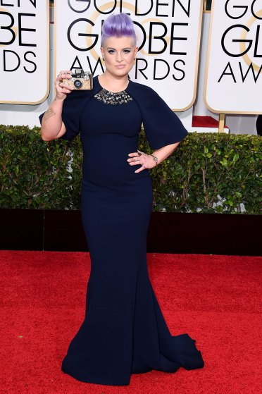 Kelly Osbourne arrives to the 72nd Annual Golden Globe Awards in Christian Siriano