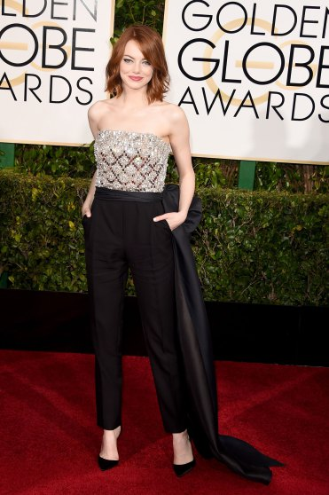 Emma Stone arrives to the 72nd Annual Golden Globe Awards in LANVIN jumpsiut