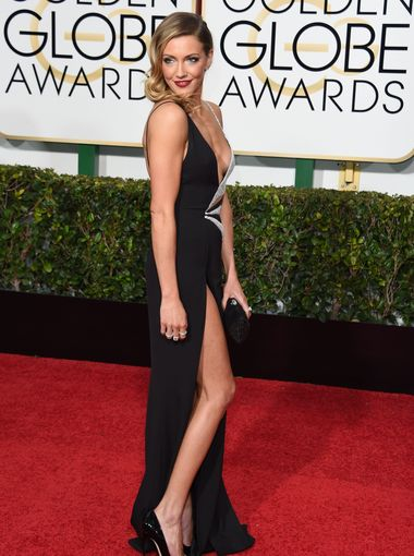 Katie Cassidy arrives to the 72nd Annual Golden Globe Awards in Black Canary Couture