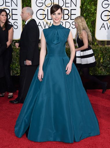 Felicity Jones  arrives to the 72nd Annual Golden Globe Awards in DIOR gown
