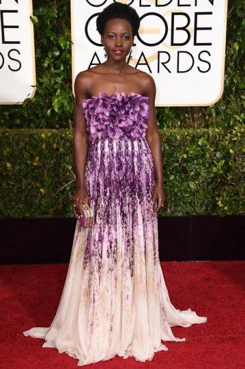Lupita Nyongo arrives to the 72nd Annual Golden Globe Awards in Giambattista Valli gown