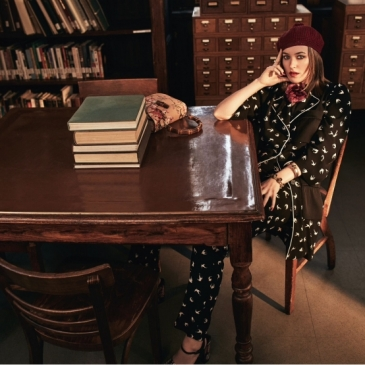 Shirt and pants by Sonia Rykiel; sandals by Tory Burch; hat, flower brooch, bracelet and bag (on table) by Gucci; (right hand) ring by Delfina Delettrez; (left hand) cuff by Marn
