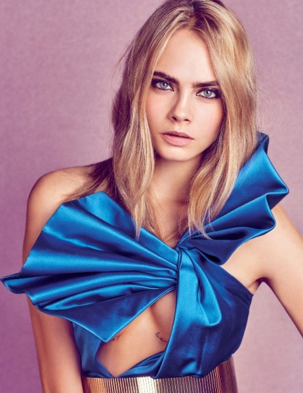 Cara Delevingne wears a Saint Laurent top and belt.