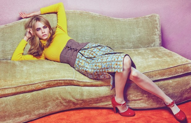 Cara Delevingne wears a Dior sweater and skirt; (right hand, from left) David Yurman ring, Sabine Getty ring; Prada corset and shoes; Wolford tights.