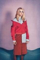 Cara Delevingne wears a Balenciaga jacket, shirt, and skirt; Maria La Rosa socks.