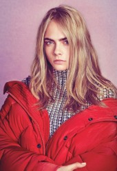 Cara Delevingne wears a Balenciaga jacket and turtleneck.