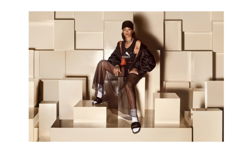Rihanna modeling fur slides from her Fenty x Puma line.