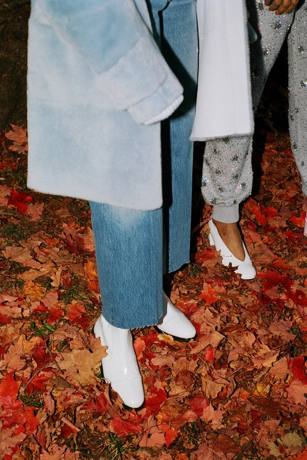 Miu Miu Blue Shearling Coat, Jacquemus Blue Giant Shoulder Turtleneck, Re/Done Blue The Leandra Jeans, Courrèges White Zippered Boots / SSENSE Exclusive Ashish Grey Sequin Lounge Pants, McQ Alexander Mcqueen White Patent Pembury Heels